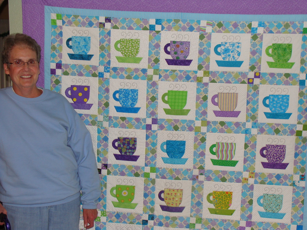 My mom, marlene schaeffer, with her tea cup quilt.