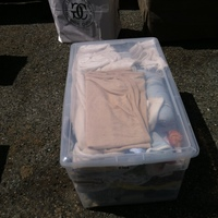 0308: Clear Plastic Bin of Baby Clothes