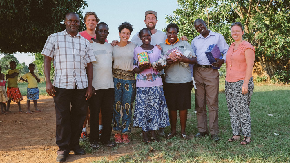The whole team, with teachers and headteacher. at the end of the shoot, doing a lovely bit of gift-giving.