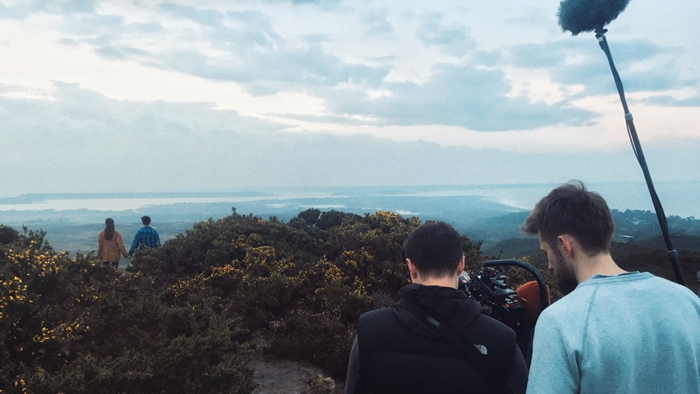 Our lovers admiring the view from Memory Point, where, if you look closely you can just make out Brownsea Island - the birthplace of the Scouts