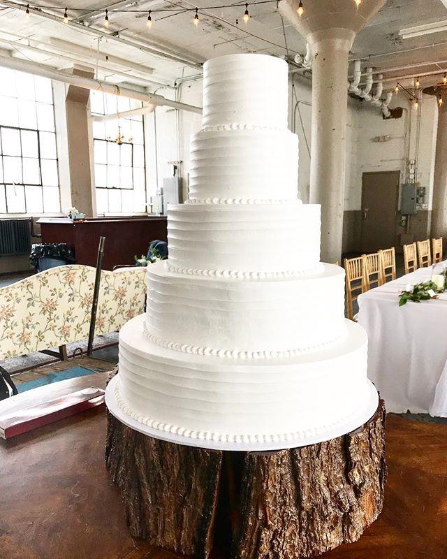 The biggest cake we ever did see 😍. . . . .#wedding #dessert  #weddingcake #industrial #warehouse #warehousewedding #lakewood #cleveland #thisiscle #clevelandbride #junewedding @theknot @brides @weddingwire @allseated @wildflourbakeryoh