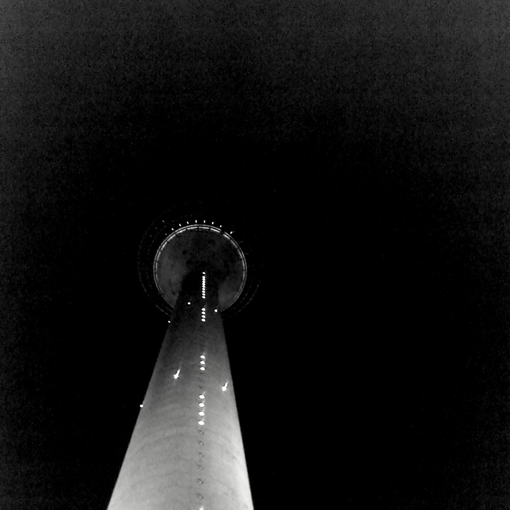 The Düsseldorf Rheinturm at night.