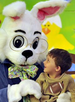 Sam Peraza, 2, smiles as he looks up at the Easter Bunny Sunday at the Upper Valley Mall. | Dayton Daily News | Bill Lackey