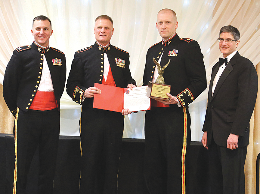 From left, Col. Steve Girard, Marine Corps Aviation Association John H. Glenn Squadron and Marine Aviation Detachment Commanding Officer; Lt. Gen. Steven Rudder, Deputy Commandant for Aviation; Maj. Robert Guyette, F-35 Pax River Integrated Test Force test pilot; and Harry Nahatis, GE Aviation, during the MCAA JGS annual awards ceremony at Naval Air Station Patuxent River, Md., Feb. 8, 2018. (Photo courtesy of Marine Corps Aviation Association John H. Glenn Squadron)
