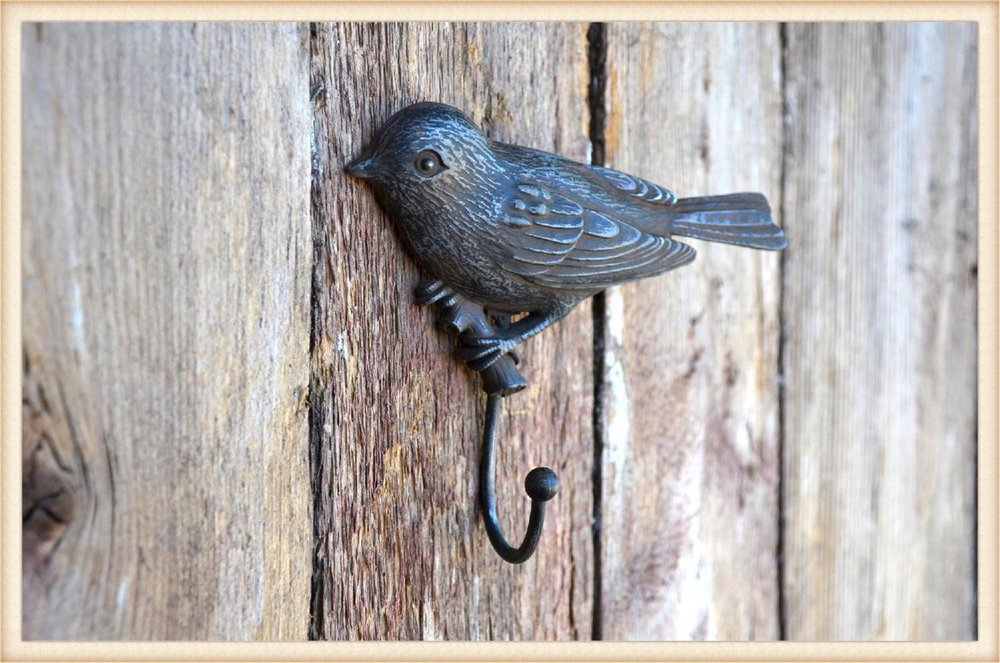 single hooks hang by the door to catch keys and the dog's leash...or mount three of them on a barn board for a dramatic look and added storage!