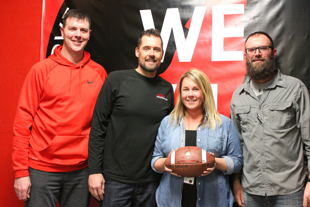 March 2018 Game Ball recipient, Jacy Duchene started at Wolf Construction as the receptionist in 2015.  Jacy quickly outgrew that role and now serves as the accounting coordinator- responsible for payroll and various other accounting functions.  More importantly, Jacy is a force behind the culture and enthusiasm of Wolf Construction.  Jacy's contagious positive attitude hasn't gone unnoticed- She is a sounding board for office staff and the field team alike.  She immediately learns your name and is insistent that Wolf Construction is more than a work place- it's a family.   Pictured:  R. VanDis, B. Hoch, J. Duchene, J. VanDis