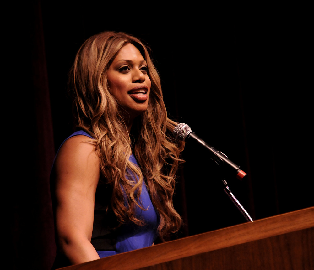 "Laverne Cox speaks at the podium at the Jorgensen Center on Wednesday, April 23, 2015. Cox is perhaps best known for her role in the Netflix original series ""Orange Is the New Black."" (Brad Watson/The Daily Campus)"