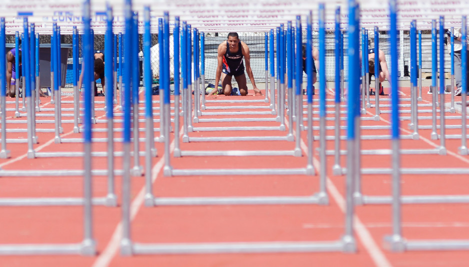 A hurdler from the UConn men's track team prepares at the starting line during a meet earlier this season. The Huskies will be looking for a solid showing at the prestigious Penn Relays this weekend. (Jason Jiang/The Daily Campus)
