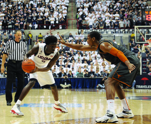 UConn men's basketball forward Daniel Hamilton is guarded by a University of Texas player in the Huskies' home game against the Longhorns on Nov. 30, 2014. (Jon Kulakofsky/The Daily Campus)