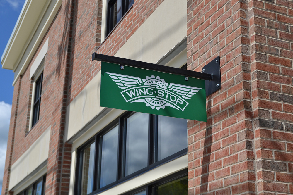 The Wingstop Storrs sign is seen in Storrs Center. The wings restaurant is open from 11 a.m. to midnight, and is located in the same building as the Hair Cuttery. (Amar Batra/The Daily Campus)