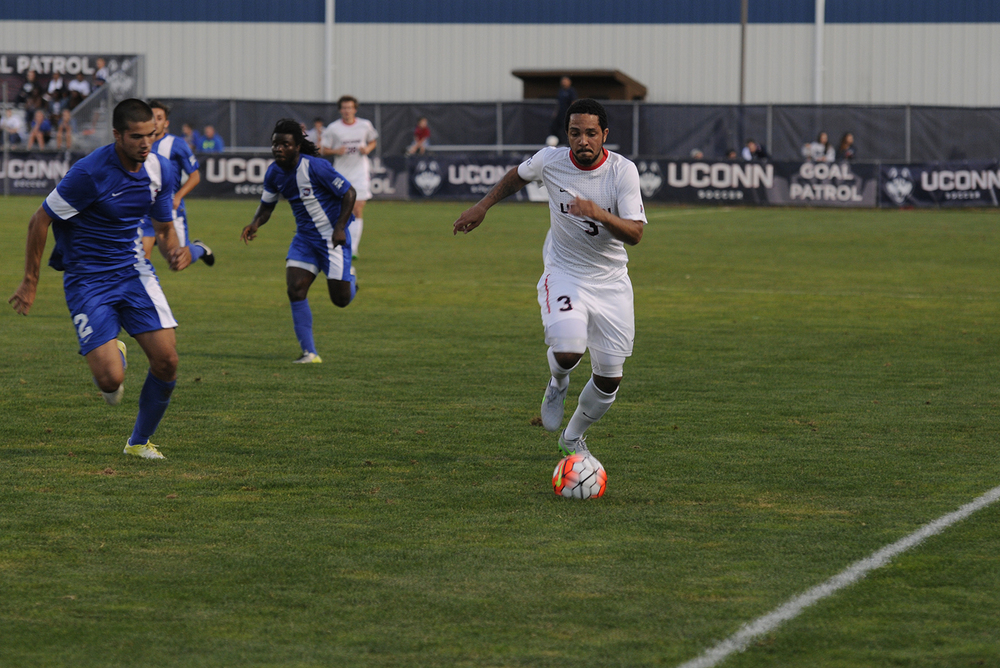 Defender Elliott Ackroyd dribbes up the field against St. Francis College at Joseph J. Morrone Stadium on Aug. 30, 2015. The Huskies drew the Terriers 0-0. (Amar Batra/The Daily Campus)
