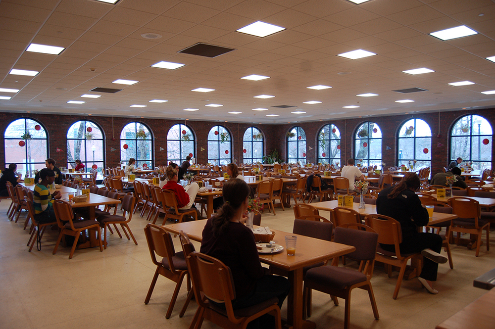 Here is a campus dining hall with students eating.