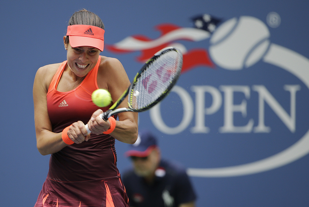 Ana Ivanovic, of Serbia, returns a shot to Dominika Cibulkova, of Slovakia, during the first round of the U.S. Open tennis tournament, Monday, Aug. 31, 2015, in New York. (Matt Rourke/AP)