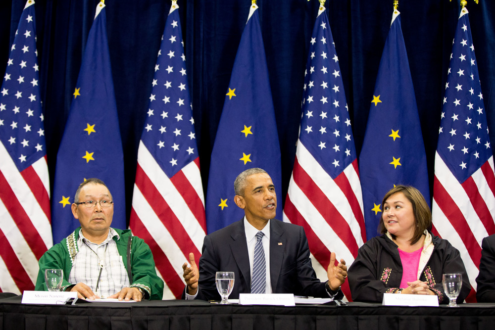 President Barack Obama, center, accompanied by President of the Association of Village Council Presidents Myron Naneng, left, and Kawerak, Inc. President and CEO Melanie Bahnke, right, participates in a roundtable at the Dena'ina Civic and Convention Center, Monday, Aug. 31, 2015, in Anchorage, Alaska. Obama opened a historic three-day trip to Alaska aimed at showing solidarity with a state often overlooked by Washington, while using its glorious but changing landscape as an urgent call to action on climate change. (Andrew Harnik/AP)