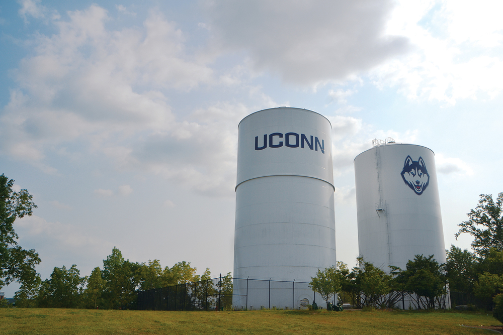 In this photo, the UConn water towers are pictured on the North side of campus, between the Towers Residence Hall complex and Husky Village. A water conservation alert has been in effect throughout the first week of classes. (Bailey Wright/The Daily Campus)