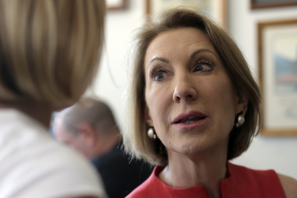 Republican presidential candidate Carly Fiorina talks to Lauren Englin, age 8, during a campaign stop at the Starboard Market Friday, Aug. 14, 2015, in Clear Lake, Iowa. (Charlie Riedel/AP)