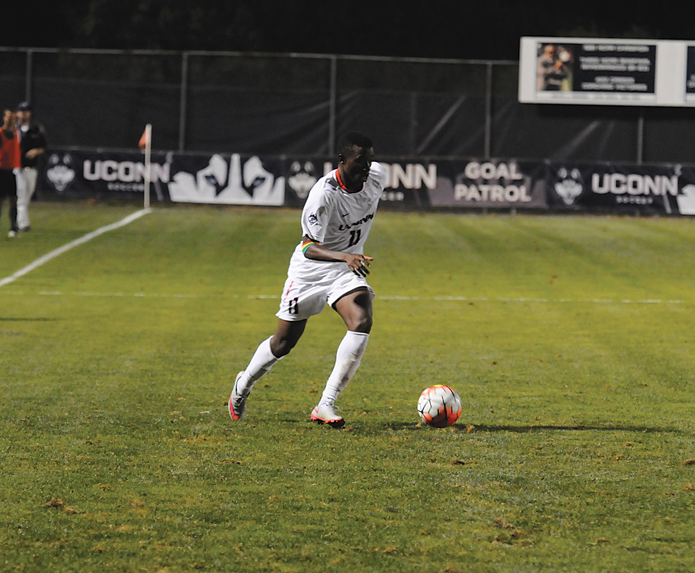UConn freshman forward Abdou Mbacke Thiam dribbles the ball during the Huskies' game against Dartmouth on Friday, Sept. 4, 2015. Thiam helped create his team's best offensive chance of the night, sending a cross from the left wing into the box that found the head of teammate Alex Sanchez. (Amar Batra/The Daily Campus)