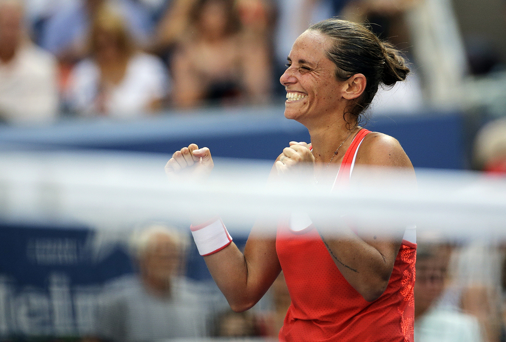 Roberta Vinci, of Italy, reacts after defeating Kristina Mladenovic, of France, during a quarterfinal match at the U.S. Open tennis tournament, Tuesday, Sept. 8, 2015, in New York. (David Goldman/AP)