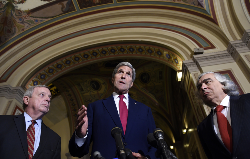 Secretary of State John Kerry, center, flanked by Sen. Richard Durbin, D-Ill., left, and Energy Secretary Ernest Moniz, right, speaks to reporters following their meeting on Capitol Hill in Washington, Wednesday, Sept. 9, 2015, on the Iran nuclear deal. (Susan Walsh/AP)