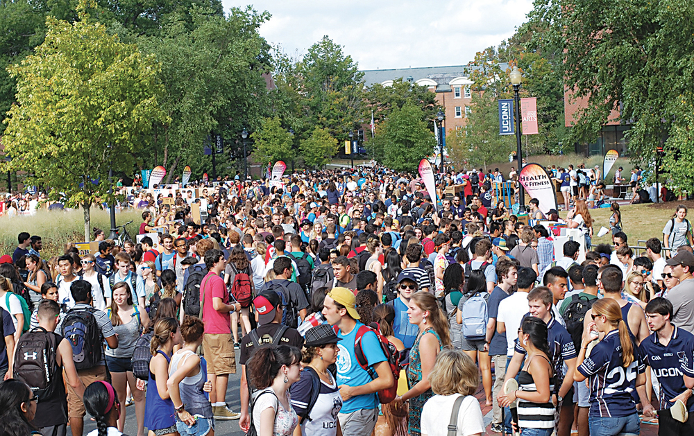 Students walk on Fairfield Way during the fall Involvement Fair on Wednesday, Sept. 9, 2015. New and returning students were welcomed by over 500 clubs and organizations. (Ashley Maher/The Daily Campus)