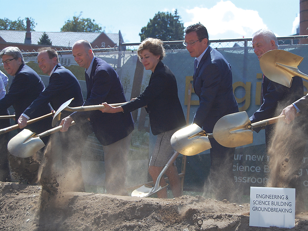(Middle, L-to-R)  State Rep. Gregg Haddad (D-Mansfield), UConn president Susan Herbst, Connecticut Gov. Dannel P. Malloy and other officials break ground on the university's new engineering building in Storrs on Wednesday, Sept. 9, 2015. (Ashley Maher/The Daily Campus)