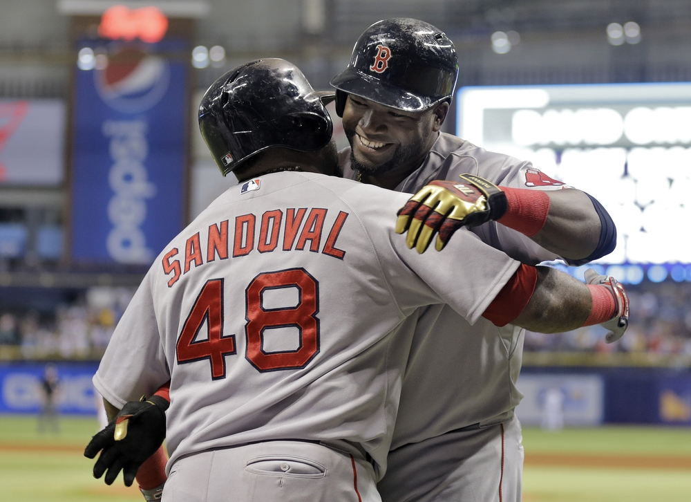 Boston Red Sox's David Ortiz, right, hugs Pablo Sandoval after Ortiz hit his 500th career home run off Tampa Bay Rays starting pitcher Matt Moore during the fifth inning of a baseball game Saturday, Sept. 12, 2015, in St. Petersburg, Florida. (Chris O'Meara/AP)
