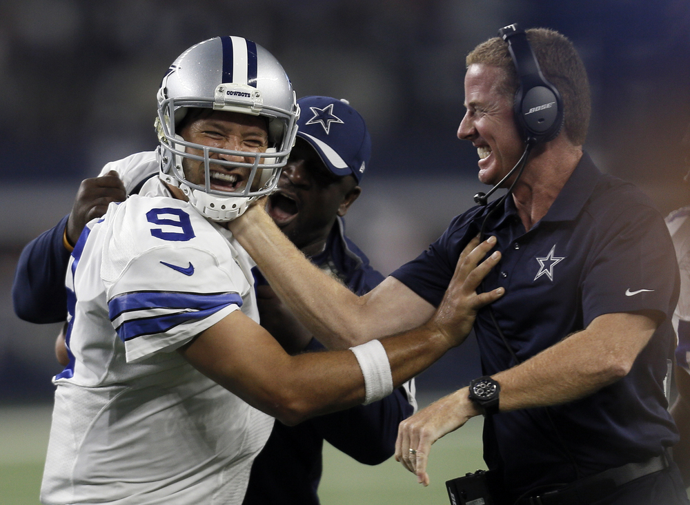 Dallas Cowboys quarterback Tony Romo and head coach Jason Garrett celebrate a last minute touchdown pass to tight end Jason Witten (82) to win against the New York Giants during the second half of an NFL football game Sunday, Sept. 13, 2015, in Arlington, Texas. Cowboys won 27-26. (Brandon Wade/AP)