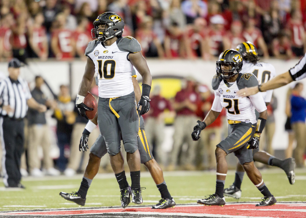 Missouri linebacker Kentrell Brothers (10) celebrates with the defense after he intercepted an Arkansas State pass during the second half of an NCAA college football game, Saturday, Sept. 12, 2015, in Jonesboro, Arkansas. (Gareth Patterson/AP)