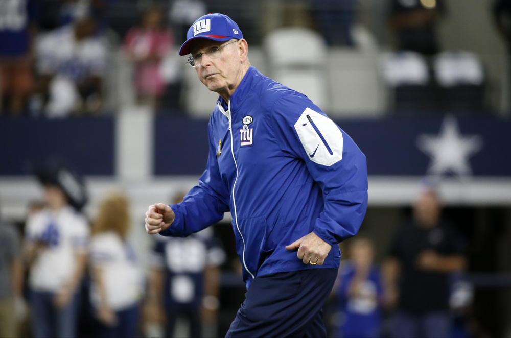 New York Giants head coach Tom Coughlin takes the field before an NFL football game against the Dallas Cowboys, Sunday, Sept. 13, 2015, in Arlington, Texas. (Tony Gutierrez/AP)
