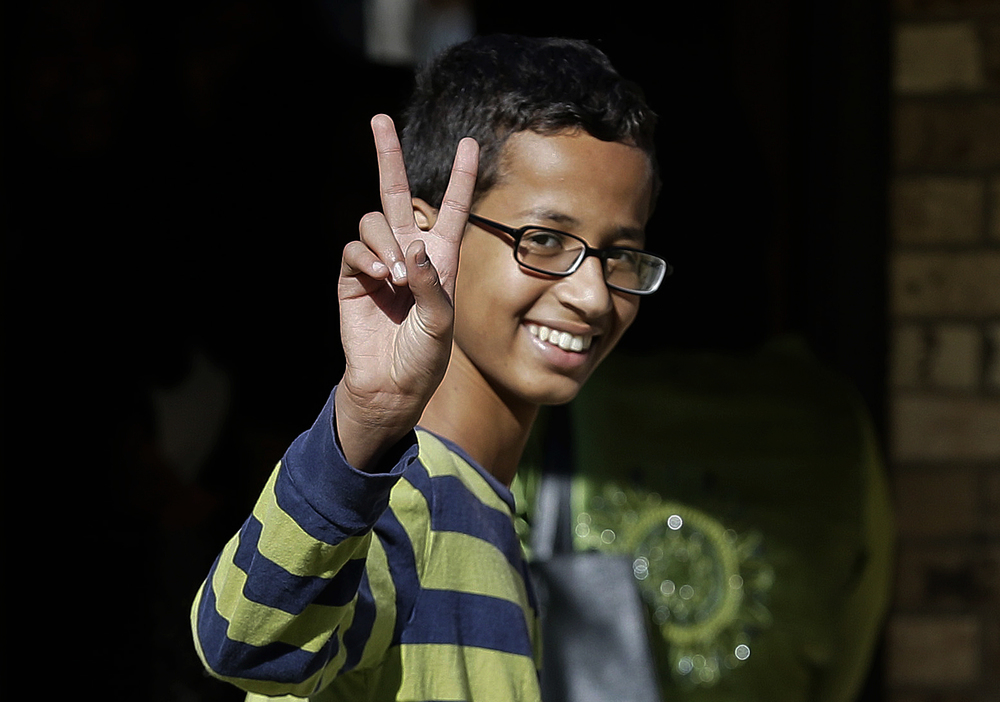 Ahmed Mohamed, 14, gestures as he arrives to his family's home in Irving, Texas, Thursday, Sept. 17, 2015. Ahmed was arrested Monday at his school after a teacher thought a homemade clock he built was a bomb. He remains suspended and said he will not return to classes at MacArthur High School. (LM Otero/AP)
