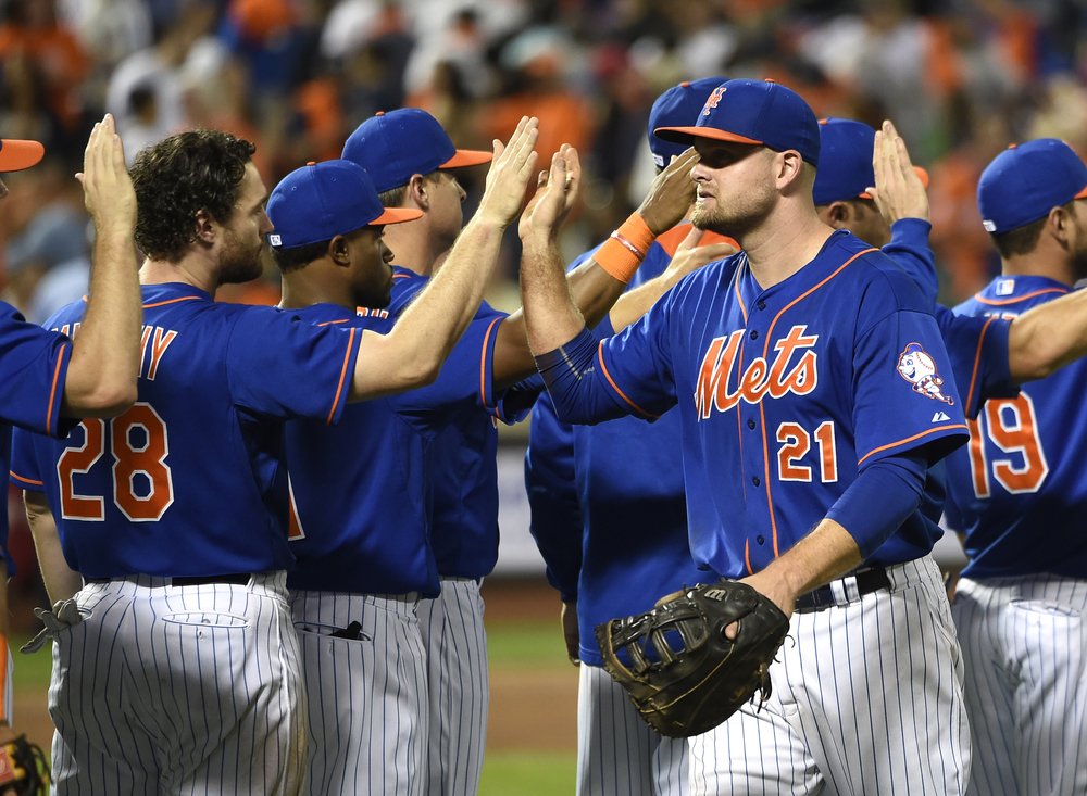 New York Mets' Daniel Murphy (28) and Lucas Duda (21) celebrate their 5-1 win over the New York Yankees in a baseball game with teammates, Friday, Sept. 18, 2015, in New York. Both Murphy and Duda hit home runs during the game. (Kathy Kmonicek/AP)