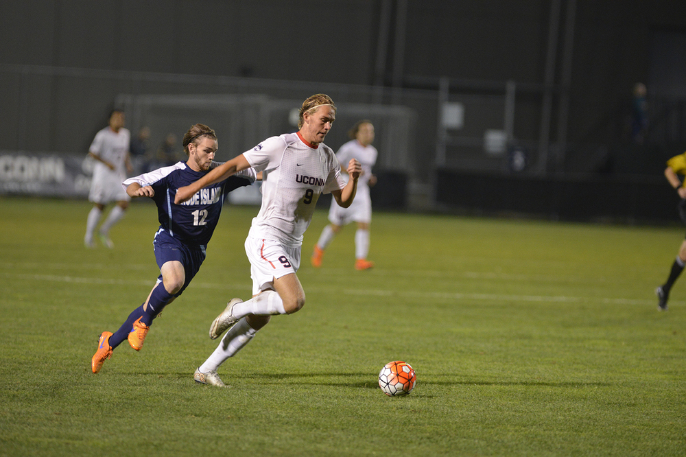 UConn men's soccer freshman forward Fredrik Jonsson dribbles downfield during the Huskies' game against Rhode Island at Joseph J. Morrone Stadium on Saturday, Sept. 19, 2015. Jonsson scored UConn's lone goal in the 1-0 victory. (Jason Jiang/The Daily Campus)