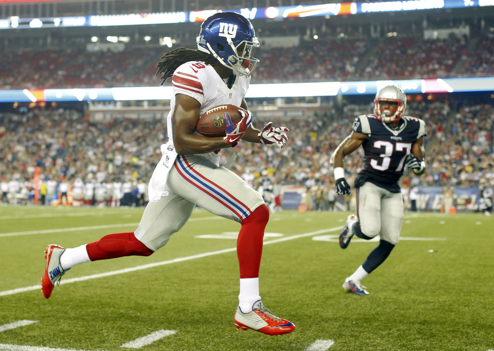 New York Giants wide receiver Geremy Davis runs along the sideline after catching a pass as New England Patriots strong safety Jordan Richards (37) pursues him in the first half of an NFL football gameThursday, Sept. 3, 2015, in Foxborough, Massachusetts. (Winslow Townson/AP)