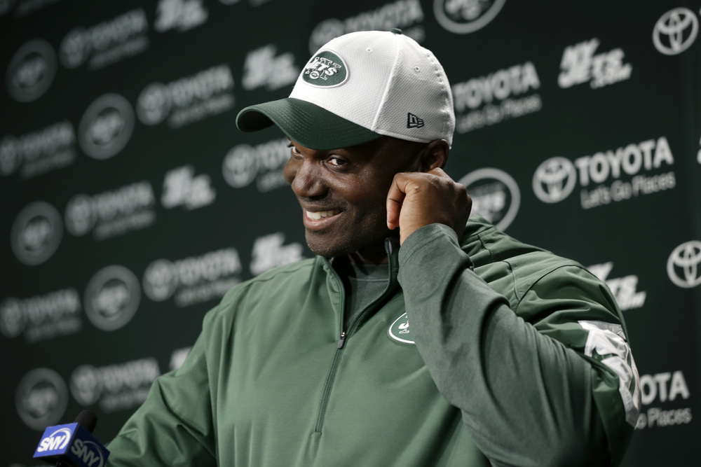 After Jets NFL football practice, New York Jets head coach Todd Bowles smiles as he listens to a question about last weekend's Temple University win over Penn State Monday, Sept. 7, 2015, in Florham Park, N.J. (Mel Evans/AP)
