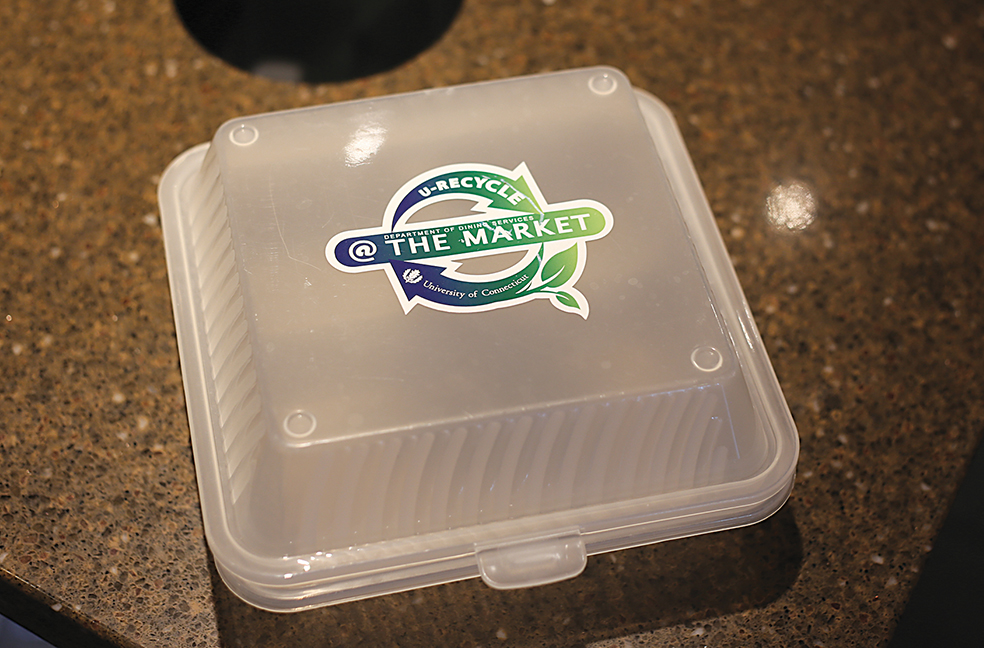 In this photo, a UConn Student Union reusable takeout container is pictured. The containers, made with 100-percent BPA free polypropylene, can then be left in a drop box in the food court to be sanitized for future use. (Jackson Haigis/The Daily Campus)