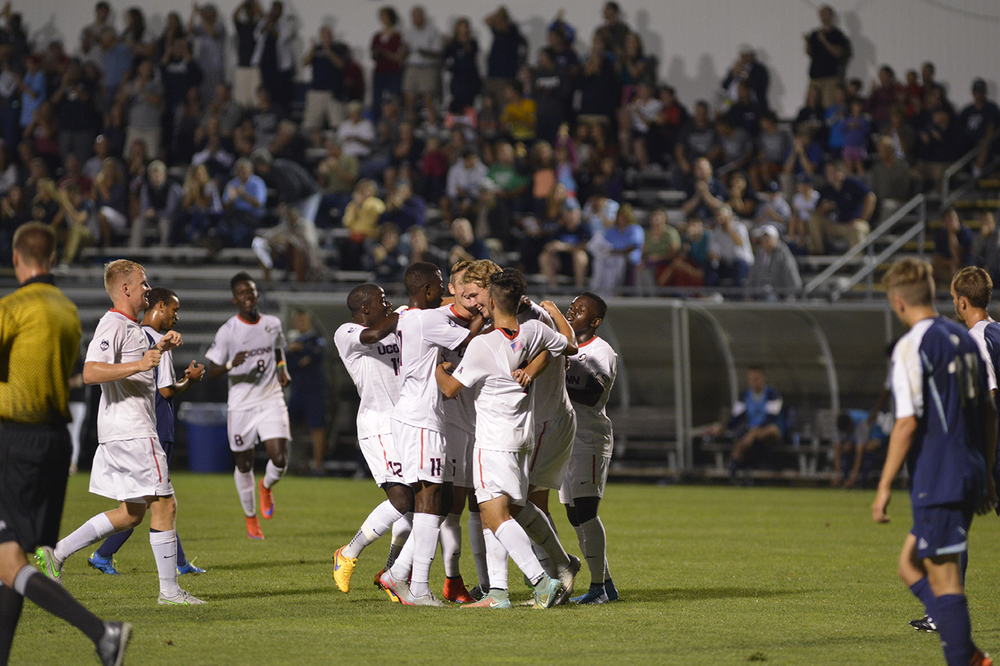 The UConn men's soccer team celebrates with freshman forward Frederik Jonsson after he scored the go-ahead goal against Rhode Island at Joseph J. Morrone Stadium in Storrs, Connecticut on Saturday, Sept. 19, 2015. (Jason Jiang/The Daily Campus)