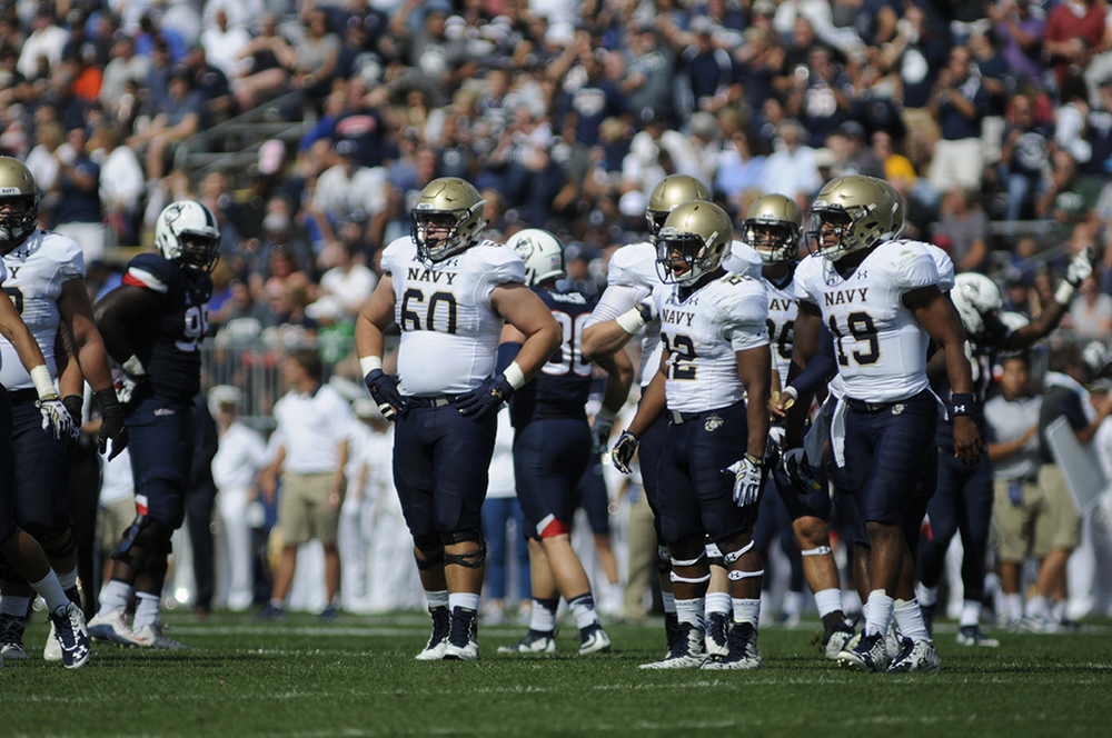 Navy quarterback Keenan Reynolds (19) stands between plays during the Midshipmen's game against UConn at Pratt & Whitney Stadium at Rentschler Field in East Hartford, Connecticut on Saturday, Sept. 26, 2015. (Bailey Wright/The Daily Campus)