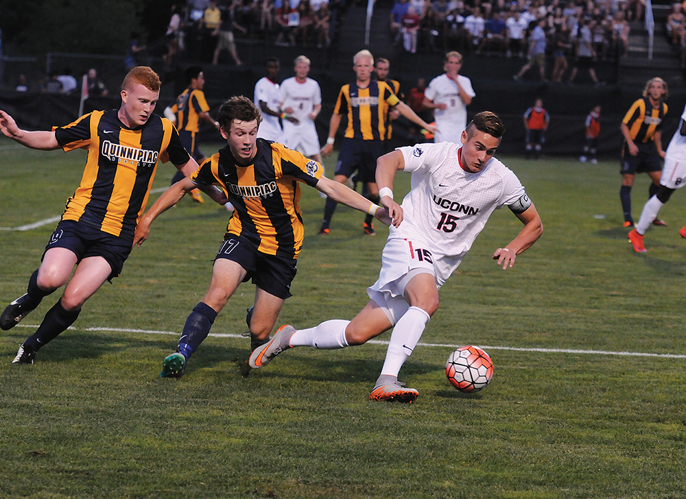 In this file photo, UConn men's soccer junior defender Jakob Nerwinski dribbles away from a Quinnipac player during the Huskies' game at Joseph J. Morrone Stadium in Storrs, Connecticut on Monday, Aug. 31, 2015. (Amar Batra/The Daily Campus)