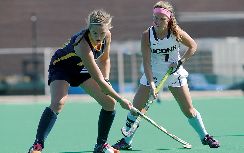 UConn senior midfielder Sophie Bowden battles for the ball against a California player during the Huskies' game at the Sherman Family Sports Complex in Storrs, Connecticut on Sunday, Sept. 27, 2015. (Jackson Haigis/The Daily Campus)