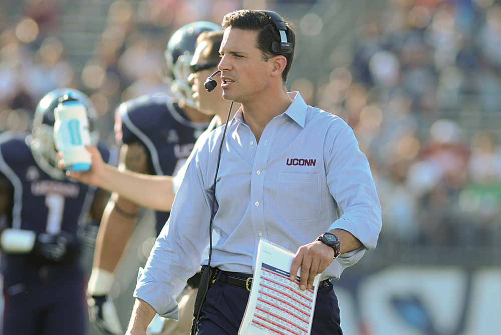 UConn football head coach Bob Diaco on the sidelines during the Huskies' game against Temple at Rentschler Field in East Hartford, Connecticut on Sept. 27, 2014. UConn opens its 2015-16 season tonight against Villanova at 7:30 p.m. (File Photo/The Daily Campus)
