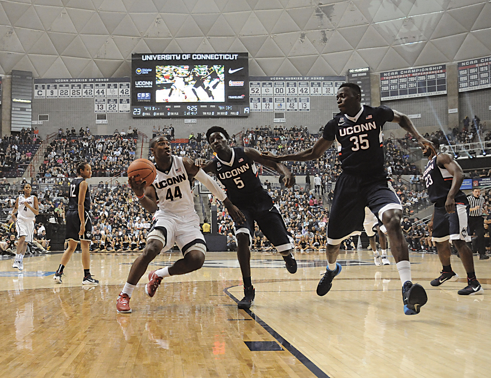 In this file photo, UConn men's basketball player Rodney Purvis drives to the basket during the First Night game on Wednesday, Oct. 1, 2014. (File Photo/The Daily Campus)