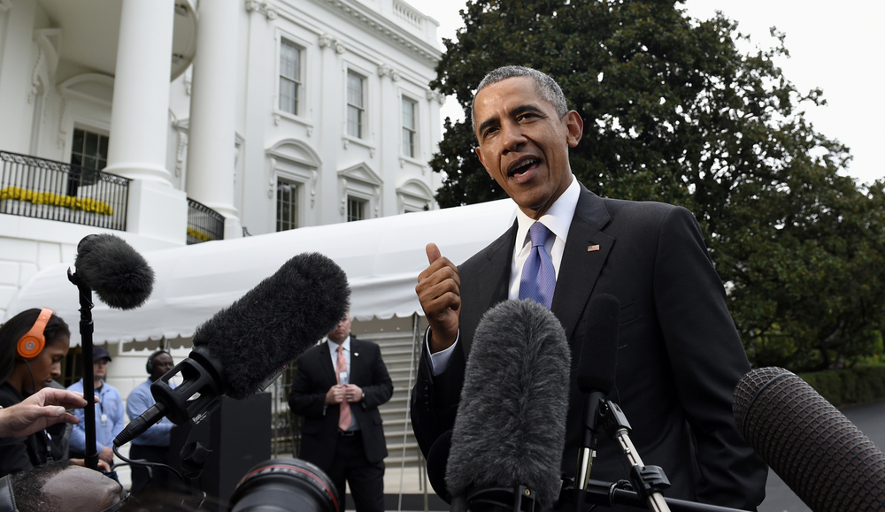 President Barack Obama speaks to reporters on the South Lawn of the White House in Washington, Tuesday, Sept. 29, 2015, after spending three days in New York and the United Nations. (Susan Walsh/AP)