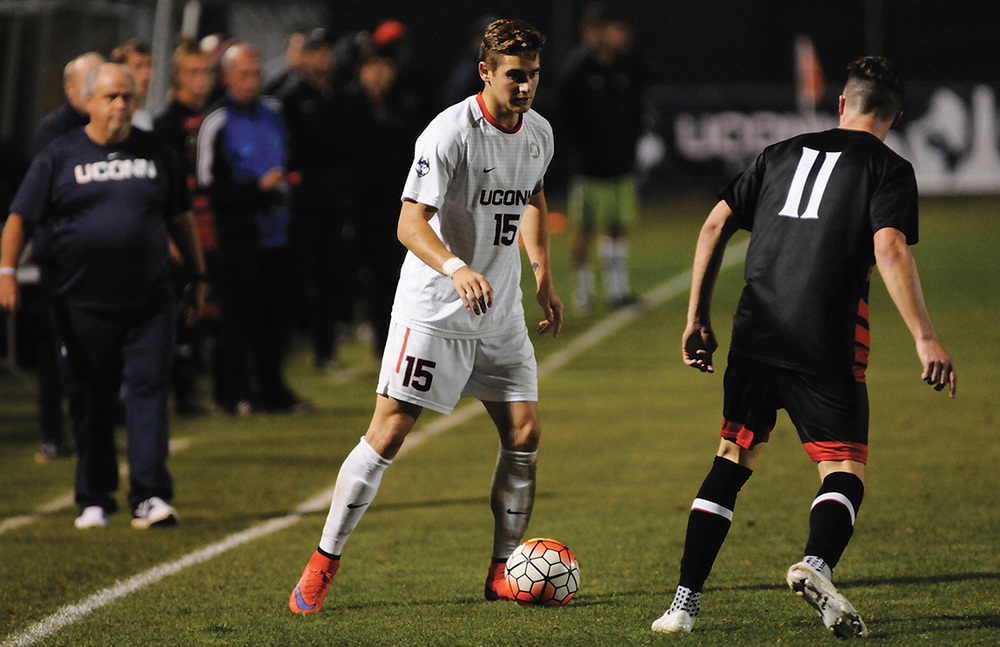 UConn men's soccer junior defender Jacob Nerwinski dribbles the ball during the Huskies' game against Cincinnati at Joseph J. Morrone Stadium in Storrs, Connecticut on Wednesday, Oct. 7, 2015. (Jackson Haigis/The Daily Campus)
