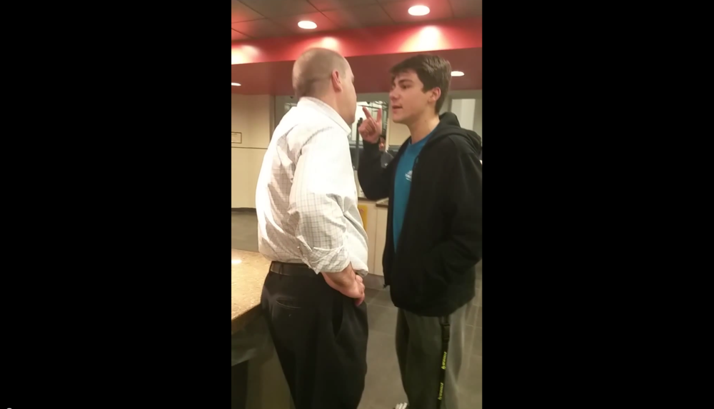 In this screenshot, UConn student Luke Gatti is seen arguing with a Student Union manager after being denied service at the Union Street Market on Sunday, Oct. 5, 2015. (Screenshot/YouTube)