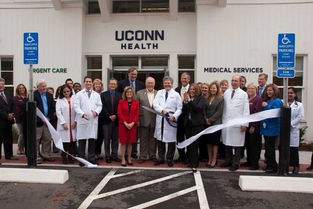 In this photo, the ribbon cutting ceremony is seen at the new UConn Health urgent care and medical office in Canton, Connecticut on Monday, Oct. 12, 2015. (Courtesy)