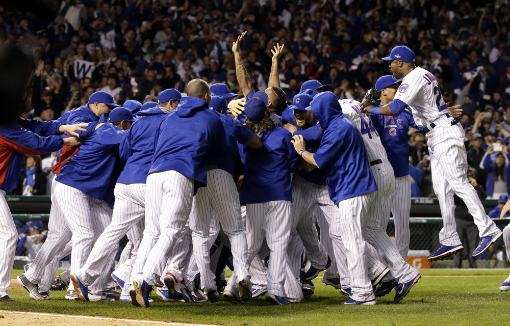 Chicago Cubs players celebrate after winning Game 4 in baseball's National League Division Series, Tuesday, Oct. 13, 2015, in Chicago. The Cubs won 4-6. (Nam Y. Huh/AP)