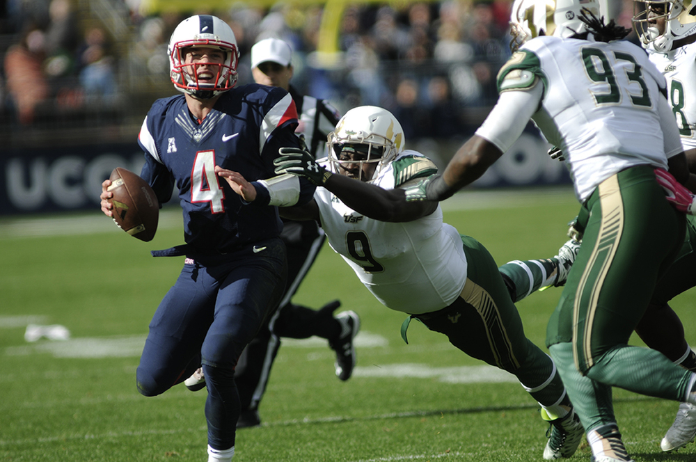 UConn quarterback Bryant Shirreffs under pressure against University of South Florida at UConn's homecoming football game on Oct. 17, 2015.