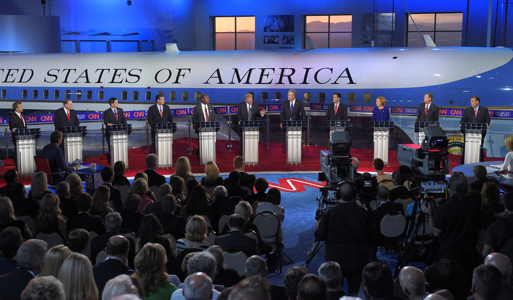 In this Sept. 16, 2015, file photo Republican presidential candidates, from left, former Arkansas Gov. Mike Huckabee, Sen. Marco Rubio, R-Fla., Sen. Ted Cruz, R-Texas, retired neurosurgeon Ben Carson, businessman Donald Trump, former Florida Gov. Jeb Bush, Wisconsin Gov. Scott Walker, businesswoman Carly Fiorina, and Ohio Gov. John Kasich, appear during the Republican presidential debate at the Ronald Reagan Presidential Library and Museum in Simi Valley, Calif. (Chris Carlson, File/AP)