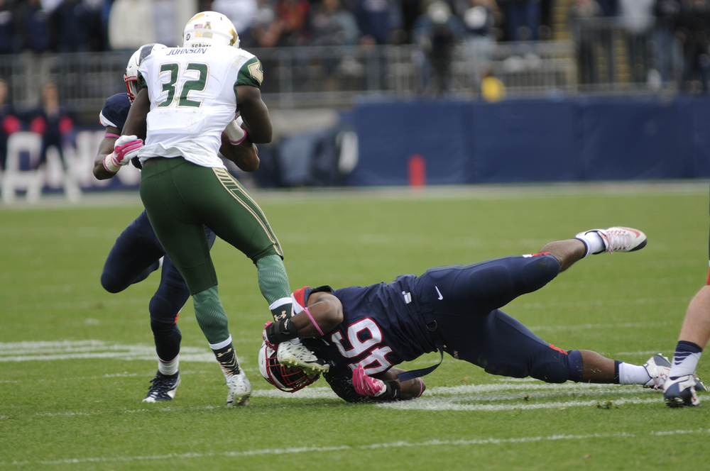 UConn linebacker Marquise Vann tackles South Florida D'Ernest Johnson during the Huskies' game against USF at Pratt & Whitney Stadium at Rentschler Field in East Hartford, Connecticut on Saturday, Oct. 17, 2015. (Bailey Wright/The Daily Campus)