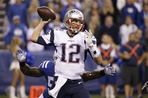 New England Patriots quarterback Tom Brady (12) throws against the Indianapolis Colts in the first half of an NFL football game in Indianapolis, Sunday, Oct. 18, 2015. (AP Photo/John Minchillo)